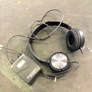 A set of headphones from the Little Revolution rehearsal room.